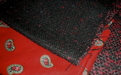 Fabric Black and red boucle that I found on sale at Hancock Fabrics in Madison, WI. This was probably a really poor choice—it unraveled instantaneously, was difficult to work with, and shed shreds all over my apartment. I decided to make the neck facings and finish the sleeves with a cotton paisley, because the boucle was so bulky.